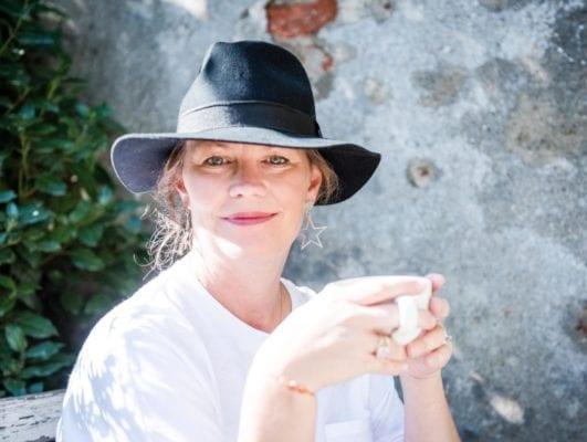 Ruth Hoskins in black dress and black hat